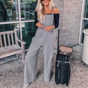 Tie on the prize striped overalls, worn once